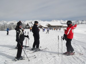 A volunteer guide gives tips to Vail Mountain visitors.